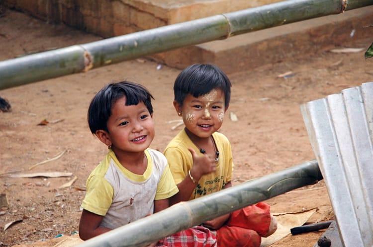 Two small Burmese kids giggle and laugh