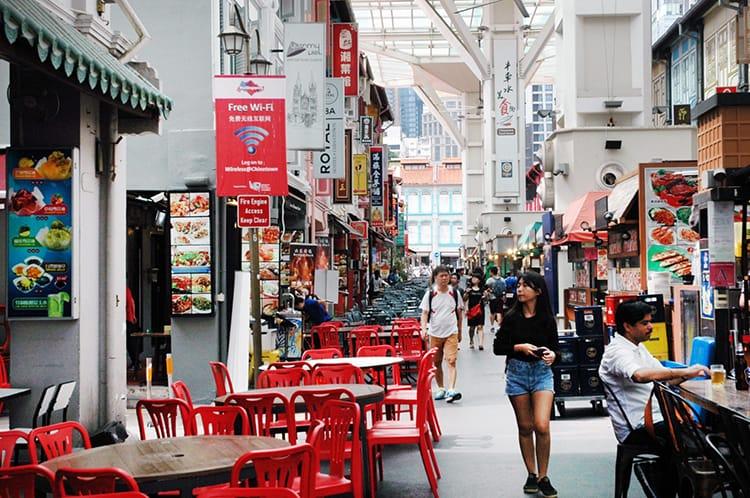 Hawker stalls line a pedestrian street in Singapore