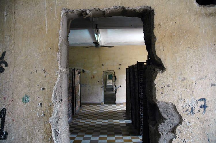 A creepy hallway in the desolate prisoner cells of S21 Prison in Phnom Penh, Cambodia