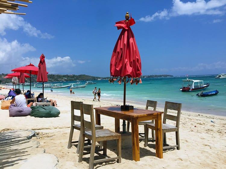 Restaurant tables lined up on Jungut Batu Beach