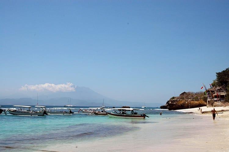 Boats float in the water at Mushroom Beach in Nusa Lembongan, Bali