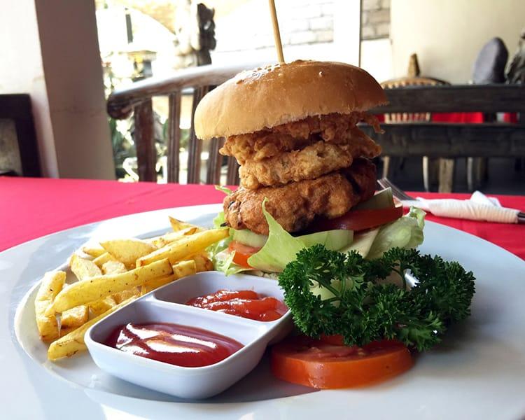 A calamari burger and fries at Pondok Baruna Warung Restaurant in Nusa Lembongan Bali