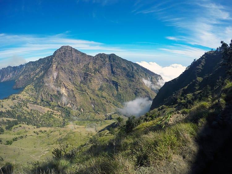 Beautiful green mountains surround Mount Rinajni