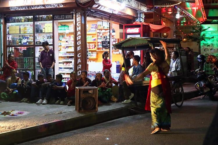 Children perform dances in the street for money during Tihar in Nepal