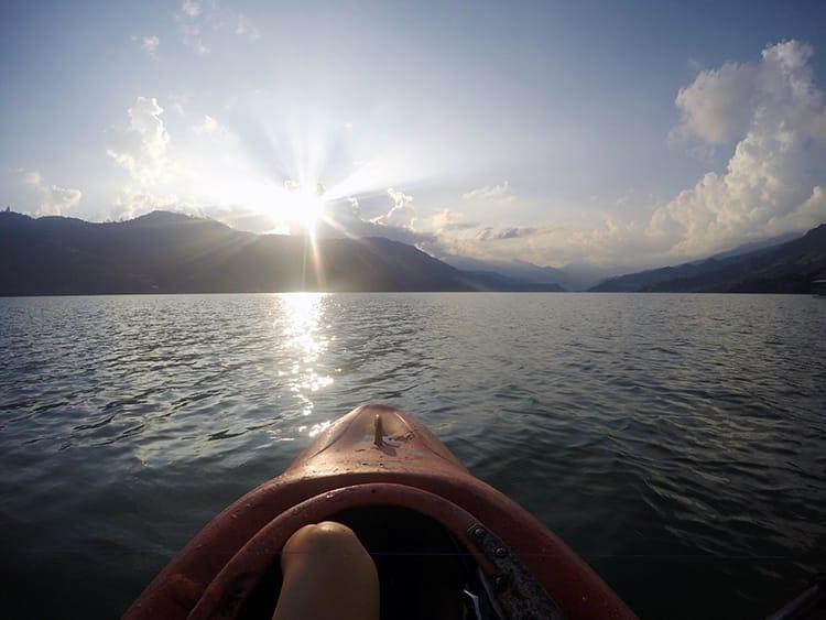 A Kayak sits on Phewa lake in Pokhara, Nepal