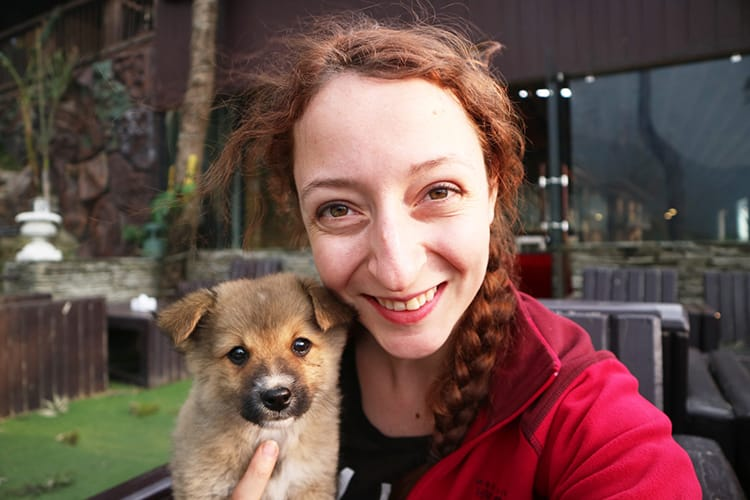 Michelle Della Giovanna from Full Time Explorer holds a tiny puppy at Green Valley Resort