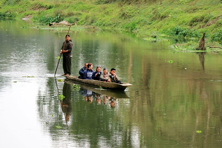 Michelle Della Giovanna from Full Time Explorer and family take a canoe ride down the river in Chitwan National Park