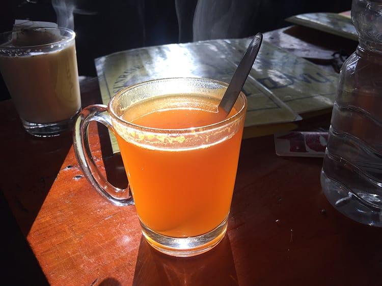A cup of bright orange sea buckthorn juice