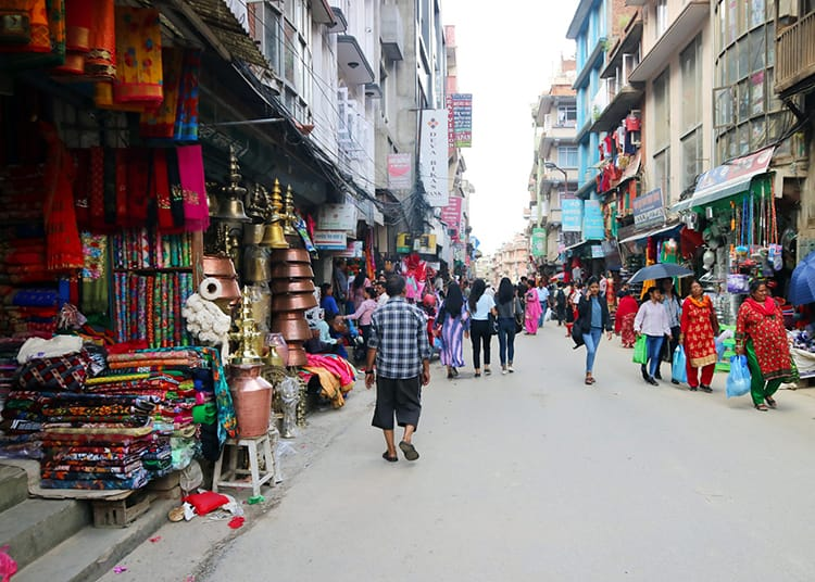 Local stores line the busy street of Mangal Bazar