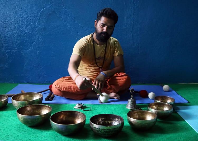 Swami Chaitanya Krishna performs signing bowl therapy in Kathmandu