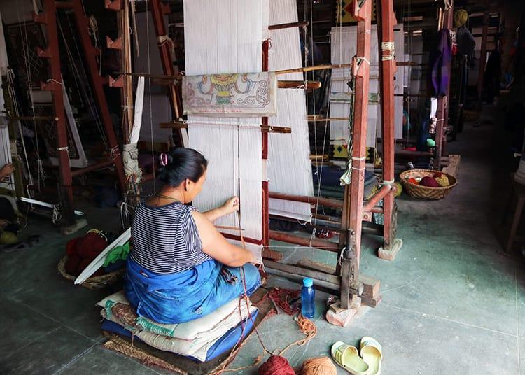 A woman weaves a Tibetan rug at Jawalakhel Handicraft Center in Patan