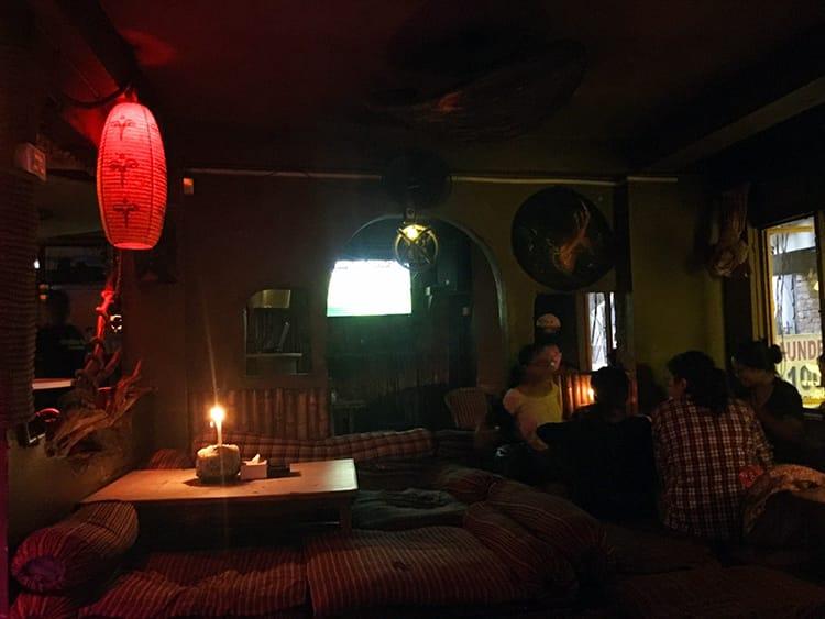 People smoke hookah inside Buddha Bar in Thamel