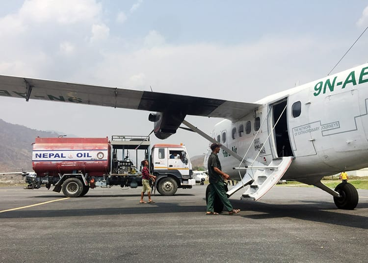 A small plane receiving more fuel before takeoff in Nepal