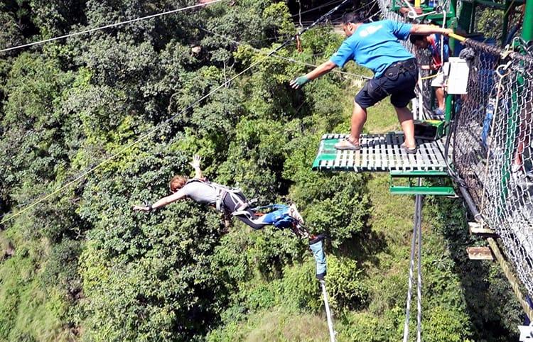 Michelle Della Giovanna of Full Time Explorer bungy jumps in Nepal