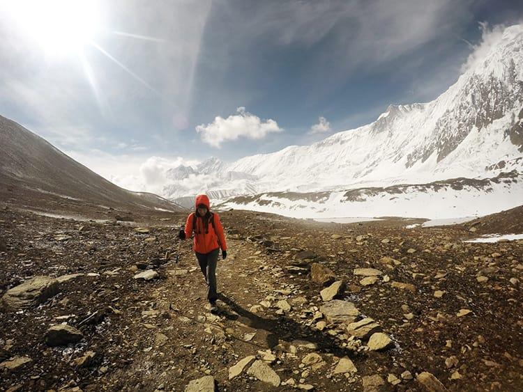 Michelle Della Giovanna of Full Time Explorer walks to Tilicho Lake on the Annapurna Circuit