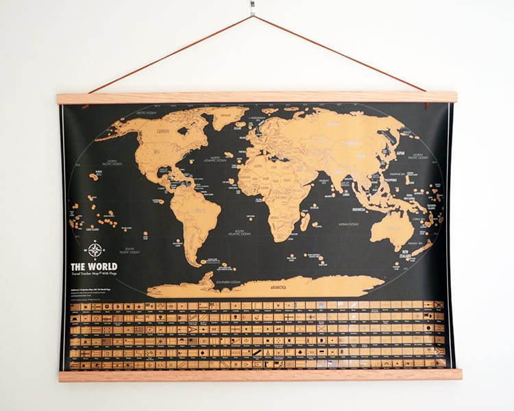 A scratch off map hangs from the wall