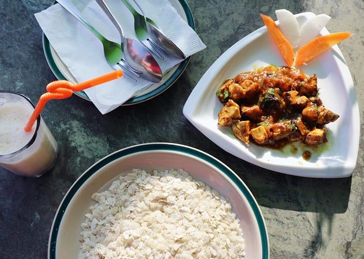 Chicken choila served with beaten rice in Bhaktapur
