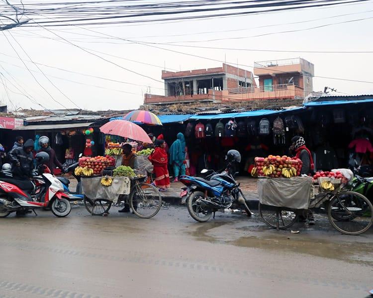 People shop from a street vendor at Kumal-Vinayak Khulla Bazar