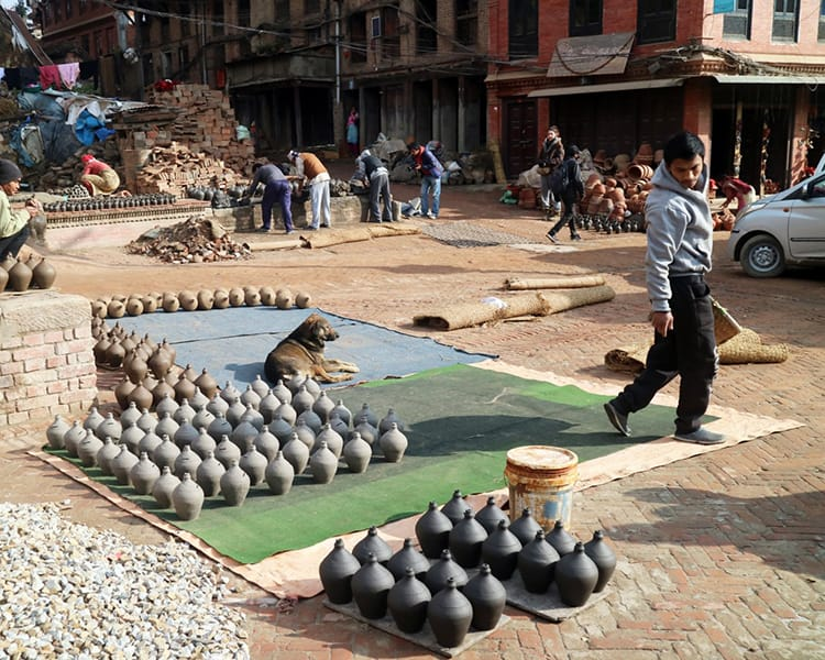 Pottery sits in the streets of Pottery Square waiting to dry in Bhaktapur
