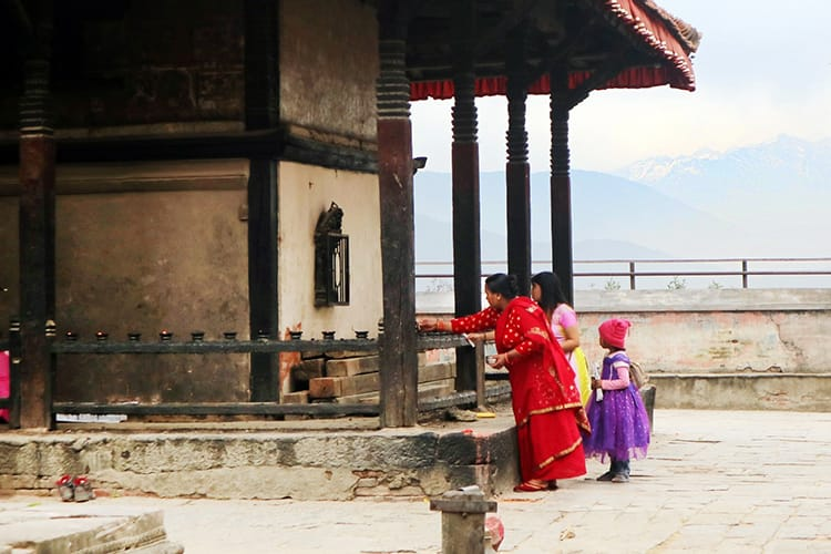 Women make offerings at the Baghbhairab Temple in Kirtipur