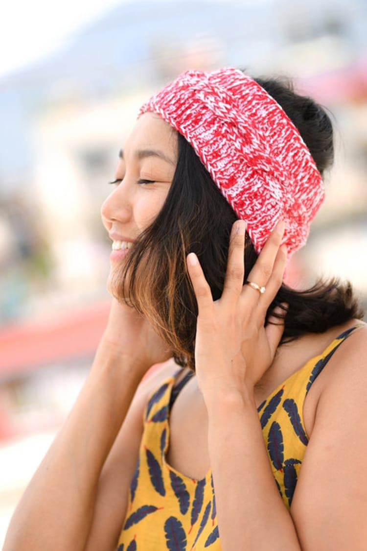 A warm winter headband made in Nepal by Aji's which has grandma's making Nepali products