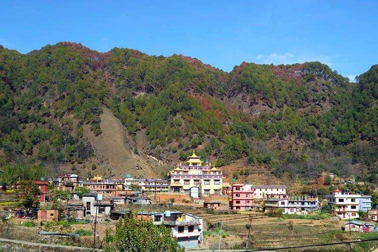 Samye Memorial Monastery sits among brightly colored homes in Pharping