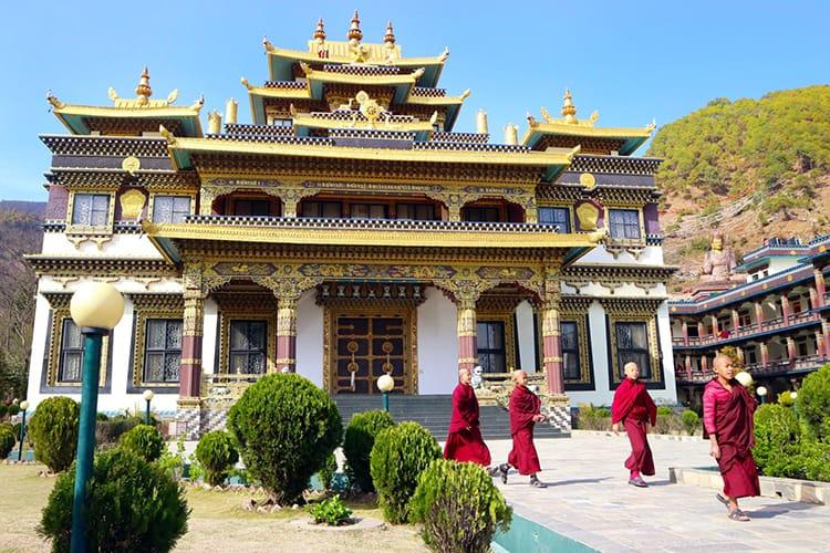 Four novice monks leave Azom Monastery to go to their dorms