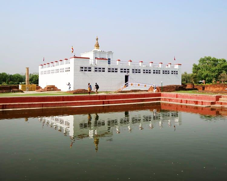 Maya Devi Temple reflected in a pond in Lumbini, Nepal