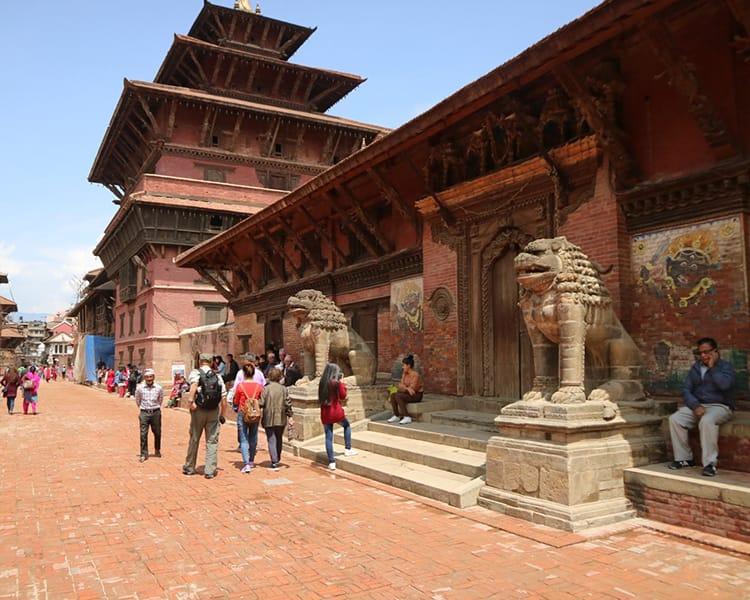 Tourists walk through Patan Durbar Square in Nepal