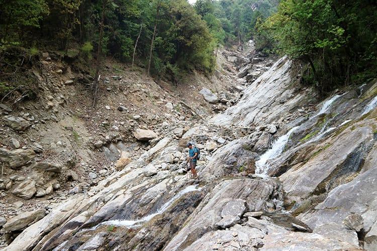 A man crosses a landslide area in Gaurishankar Conservation Area in Nepal