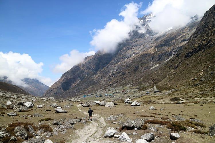 A trekkers walks back to Na from Tsho Rolpa Lake