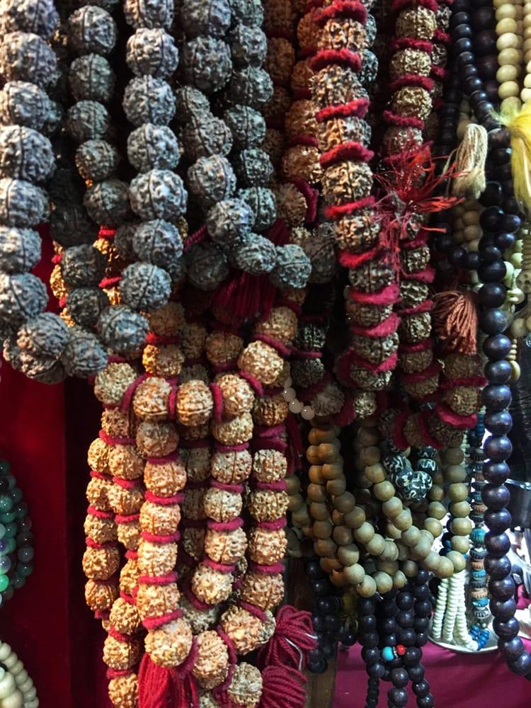 Mala beads hang on a display for sale in a souvenir shop in Kathmandu