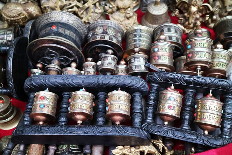 Small prayer wheels being sold at a souvenir shop in Nepal