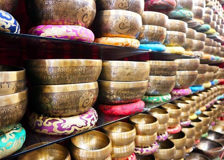 Singing bowls line the walls of a souvenir shop in Kathmandu