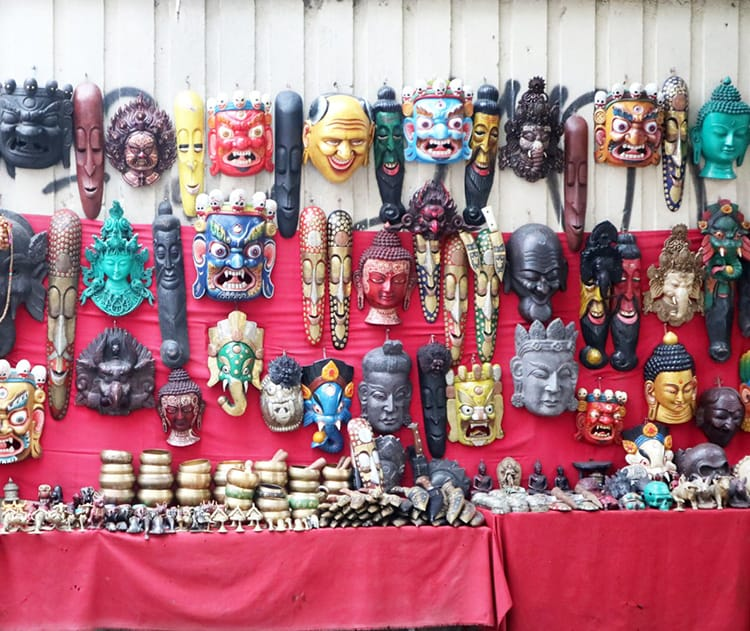 Brightly painted wood masks line the streets of Thamel to sell to tourists