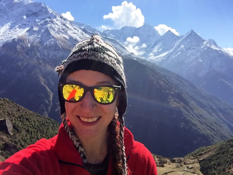 Michelle Della Giovanna of Full Time Explorer wears a yak wool hat in the Himalayas