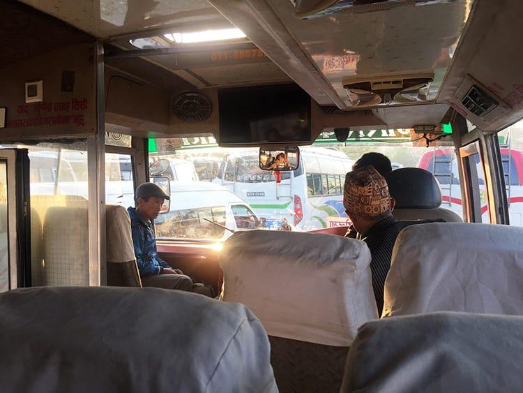People board a local bus in Kathmandu early in the morning