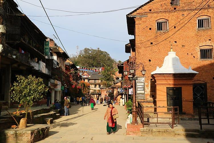 A woman walks down the streets of Bandipur Bazaar