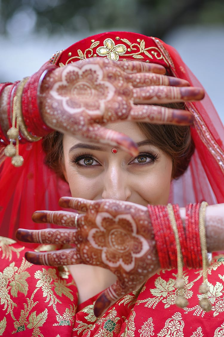 Michelle Della Giovanna from Full Time Explorer shows off her mehendi on her hands before the ceremony