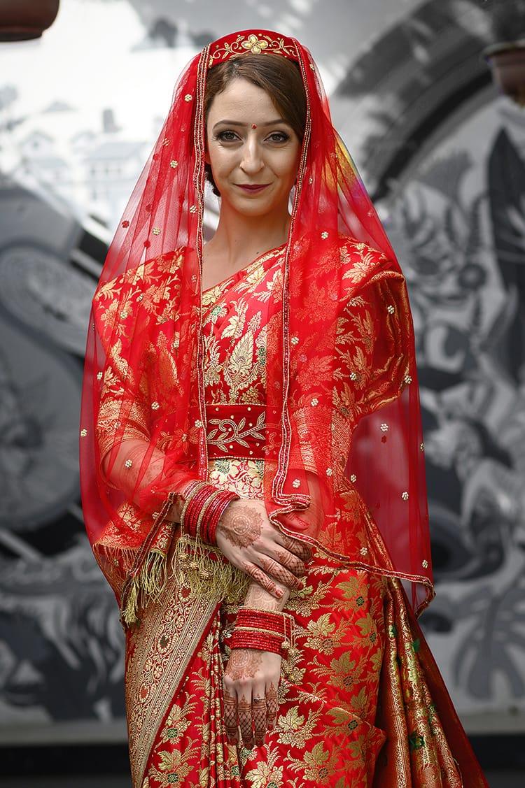 Michelle Della Giovanna from Full Time Explorer wearing a traditional Newari wedding saree