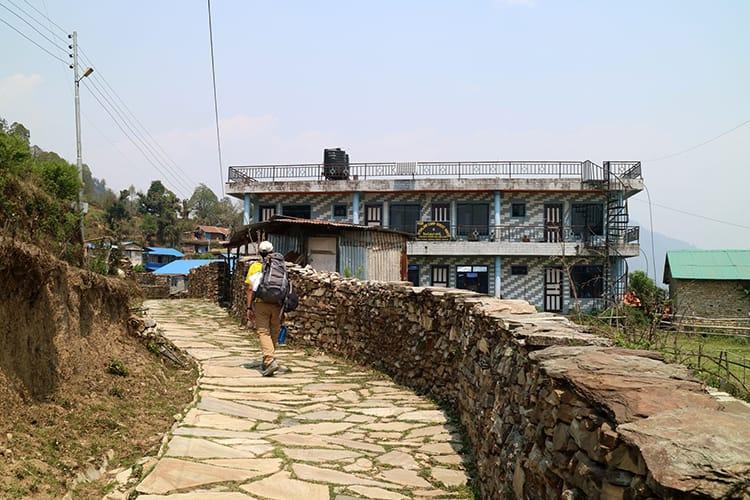 A trekker walks through the center of Australian Camp, Nepal