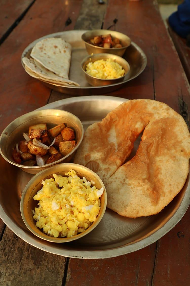 A simple breakfast including Tibetan bread, scrambled eggs, and breakfast potatoes