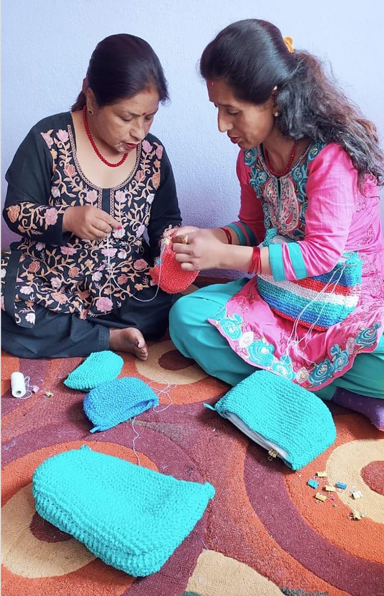 Two woman hand make purses for Samsara Creation